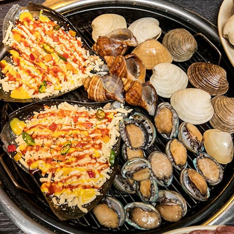 famous food in haeundae busan grilled clams and seafood