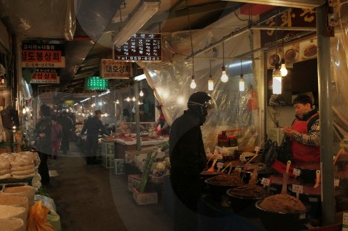 a street stall at gyeongdon market selling traditional korean herbs and oriental medicine in the open air flea style market