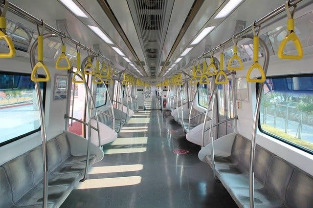 the interior of a korean subway on its way to Busan from Seoul